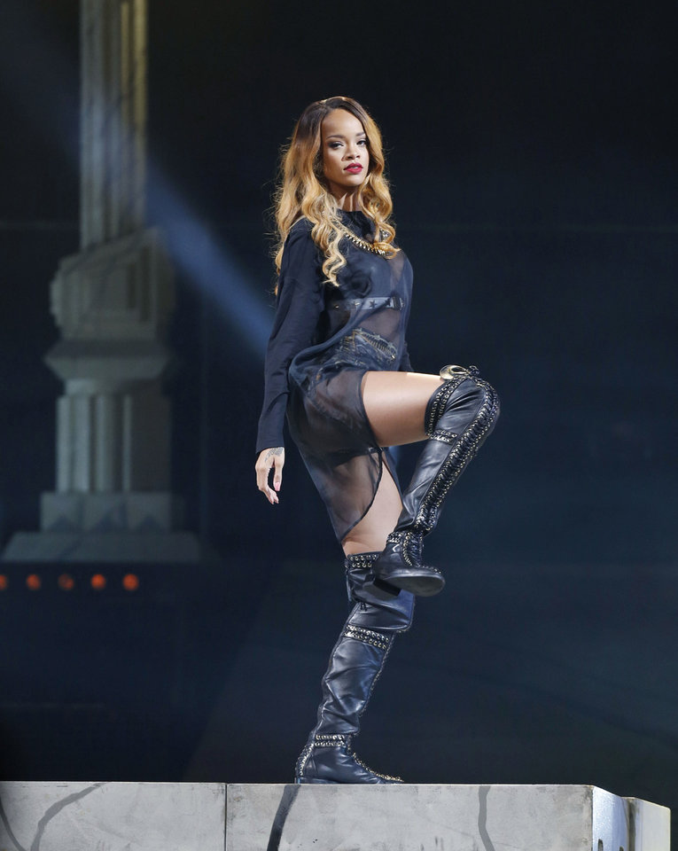 Photo - Rihanna performs in concert on Monday, May 6, 2013 in Boston. (Photo by Bizuayehu Tesfaye/Invision/AP) ORG XMIT: MABT106