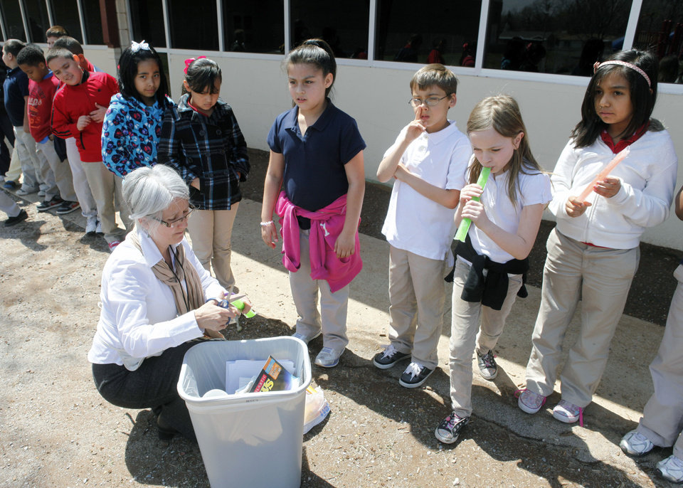 Third grade teacher Sharon Scott hands popsicles to her class as a reward for studying for state exams at Coolidge Elementary School in Oklahoma City, OK, Thursday, April 4, 2013,  By Paul Hellstern, The Oklahoman
