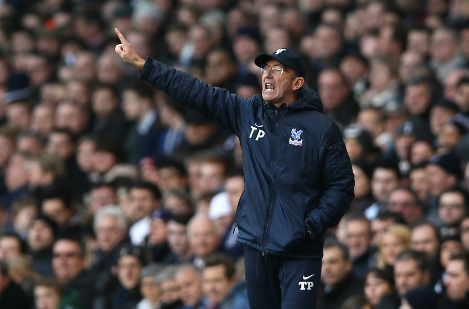 Photo - Crystal Palace's manager Tony Pullis points to his players as he watches them from the technical area during their English Premier League soccer match between Tottenham Hotspur and Crystal Palace at the White Hart Lane stadium in London Saturday, Jan. 11,  2014. (AP Photo/Alastair Grant)