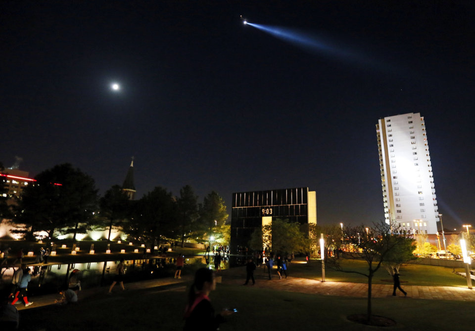Photo - A helicopter shines a searchlight over the Oklahoma City National Memorial before the Oklahoma City Memorial Marathon in Oklahoma City, Sunday, April 28, 2013. Photo by Nate Billings, The Oklahoman