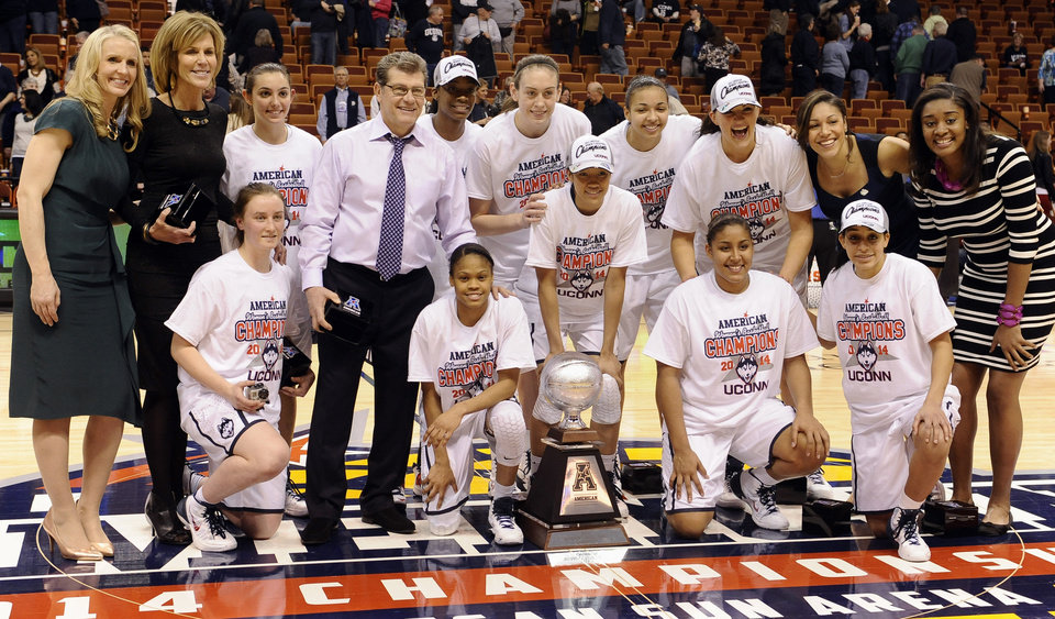 Photo - The Connecticut team poses for a photograph with their trophy after winning an NCAA college basketball game in the finals of the American Athletic Conference women's basketball tournament against Louisville, Monday, March 10, 2014, in Uncasville, Conn. Connecticut won 72-52. (AP Photo/Jessica Hill)