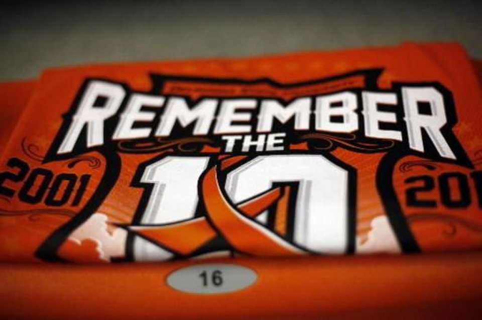 """Remember the 10"" T-shirt sitson the seats of Gallagher-Iba Arena before the basketball game between Oklahoma State and Texas, Wednesday, Jan. 26, 2011, Stillwater, Okla. Photo by Sarah Phipps"