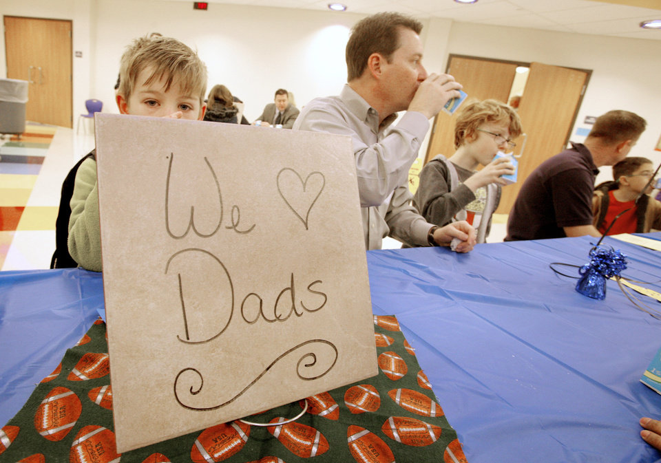 "Sign on a table in the cafeteria during a ""Donuts with Dad"" breakfast at Northwood Elementary School in Piedmont Tuesday, Jan 24, 2012. Photo by Paul B. Southerland, The Oklahoman"