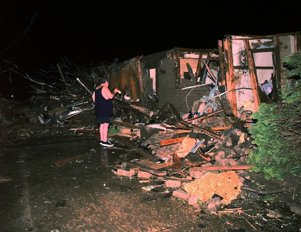May 3, 1999 Oklahoma City Tornado:   Edward Evett looks over the remains of his house in the 4200 block of Angela Drive in Del City.  He and wife went to their storm cellar during the tornado.  Staff Photo by Bryan Terry