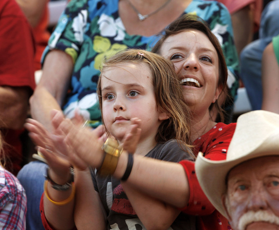 Photo - CHILD / CHILDREN / KIDS: Giorgia Campello, 4, and her aunt, Jody White, clap for the performers during the Pawnee Bill Wild West Show at the Pawnee Bill Ranch in Pawnee, Oklahoma on Saturday,   June 23, 2012.  White lives in Ames, Oklahoma. Campello lives in Rome, Italy and is here with her family visiting relatives, Photo by Jim Beckel, The Oklahoman