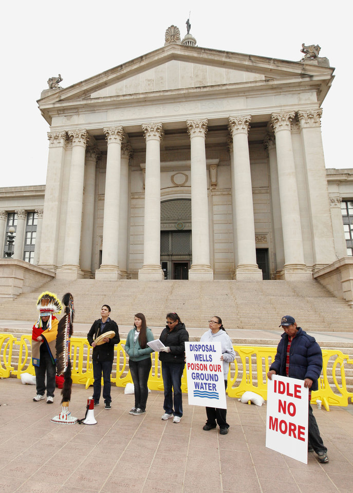 Photo - Protesters listen to speakers Friday from Idle No More Central Oklahoma as Oklahoma tribal members gather on World Water Day to protest against ground water contamination and the Keystone XL pipeline at the state Capitol in Oklahoma City. Photos by Paul B. Southerland, The Oklahoman
