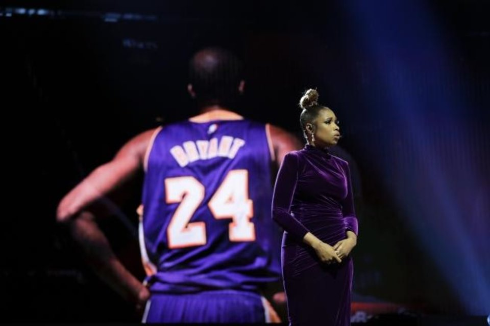 Photo -  Jennifer Hudson sings a tribute at the NBA All-Star game in Chicago to former All-Star Kobe Bryant and his daughter Gianna, who were killed in a helicopter crash on Jan. 26. [AP Photo/Nam Huh]