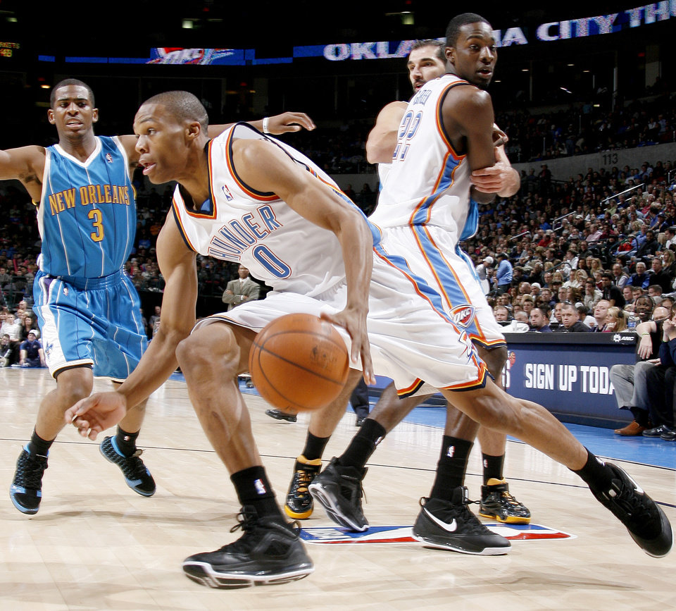 Photo - Oklahoma City's Russell Westbrook drives past teammate Jeff Green as Chris Paul and Peja Stojakovic of New Orleans watch during NBA basketball game between the Oklahoma City Thunder and the New Orleans Hornets at the Ford Center in Oklahoma City on Friday, Nov. 21, 2008.  BY BRYAN TERRY, THE OKLAHOMAN ORG XMIT: KOD