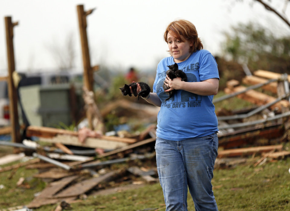 Rachel Hilton holds stray kittens she found in the debris of her parents' home at SW 149th and Stone Meadows Dr. after a tornado struck south Oklahoma City and Moore, Okla., Monday, May 20, 2013. Photo by Nate Billings, The Oklahoman