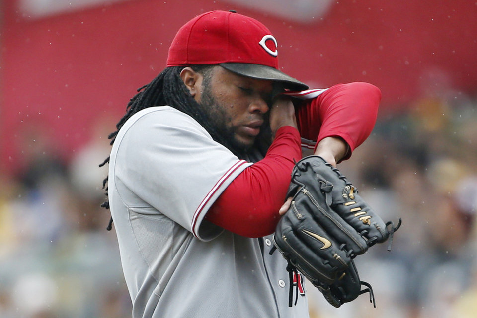 Photo - Cincinnati Reds starting pitcher Johnny Cueto wipes his face after giving up a leadoff solo home run to Pittsburgh Pirates' Josh Harrison during the first inning of a baseball game against the Pittsburgh Pirates in Pittsburgh, Sunday, Aug. 31, 2014. (AP Photo/Gene J. Puskar)