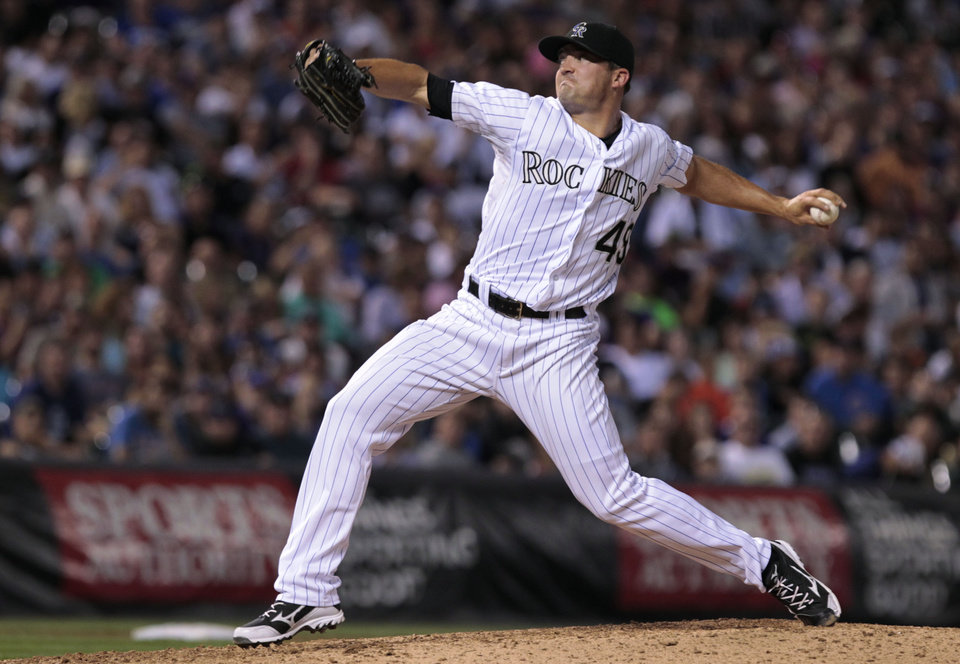 Photo - Colorado Rockies relief pitcher Rex Brothers (49) pitches in the seventh inning of a baseball game against the Chicago Cubs in Denver on Tuesday, Aug. 5, 2014. Rockies pitchers walked in two runs and allowed an RBI during the inning.(AP Photo/Joe Mahoney)