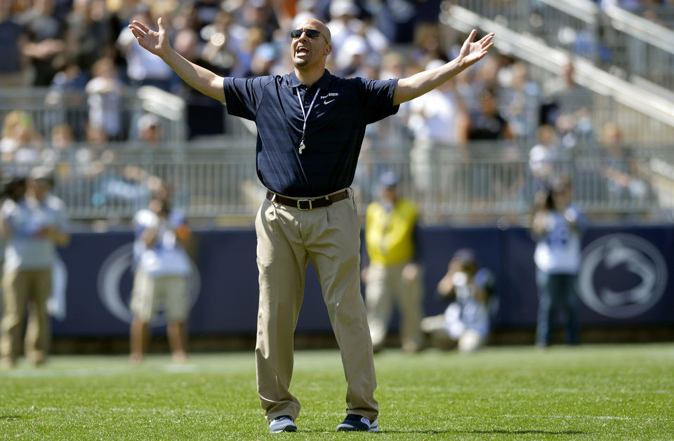 Photo - New Penn State head football coach James Franklin leads about 70,000 fans in the