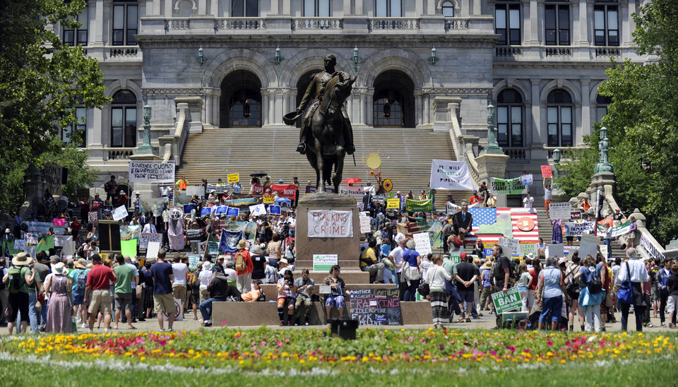 Protesters rally against hydrofracking at the Capitol in Albany, N.Y., on Monday, June 17, 2013. The demonstrators are urging Gov. Andrew Cuomo to permanently ban hydraulic fracturing for natural gas in New York, saying it will harm the environment.  (AP Photo/Tim Roske)