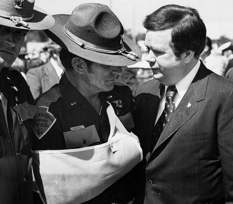 Gov. David Boren shares a quiet conversation with Oklahoma Highway Patrol Lt. Hoyt Hughes, who was wounded in a shootout with two escapees from the Oklahoma State Penitentiary in Caddo on May 26, 1978. Copy of a print from The Oklahoman Archive, Tuesday, Dec. 6, 2011.