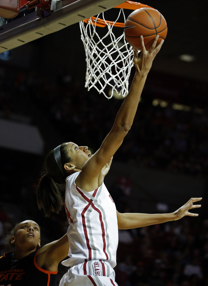 Photo - Oklahoma's Nicole Griffin (4) shoots as Oklahoma State's Kendra Suttles (31) defends during the women's Bedlam basketball game between Oklahoma State University and Oklahoma at the Lloyd Noble Center in Norman, Okla., Sunday, Feb. 10, 2013.Photo by Sarah Phipps, The Oklahoman