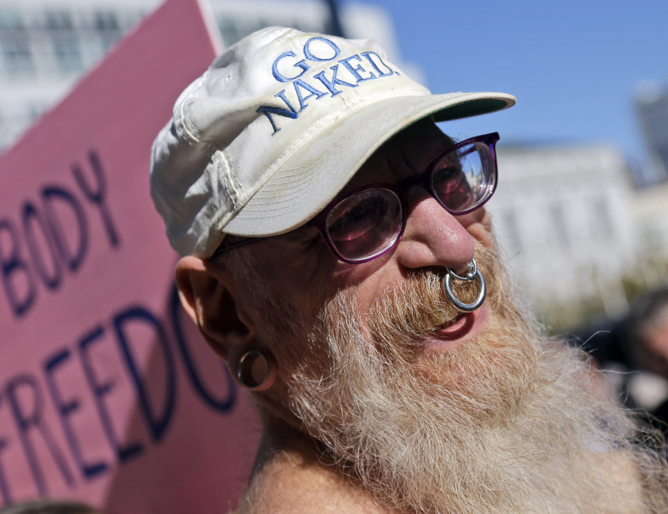 Woody Miller attends a rally in opposition to a city-wide nudity ban outside of City Hall in San Francisco, Wednesday, Nov. 14, 2012. San Francisco appears poised to shed part of its image as a city where anything goes, including clothing. The Board of Supervisors is scheduled to vote next week on a law that would ban public nudity. The proposal comes in response to a devoted group of nudists who proudly strut their stuff through the city�s Castro District. (AP Photo/Marcio Jose Sanchez)