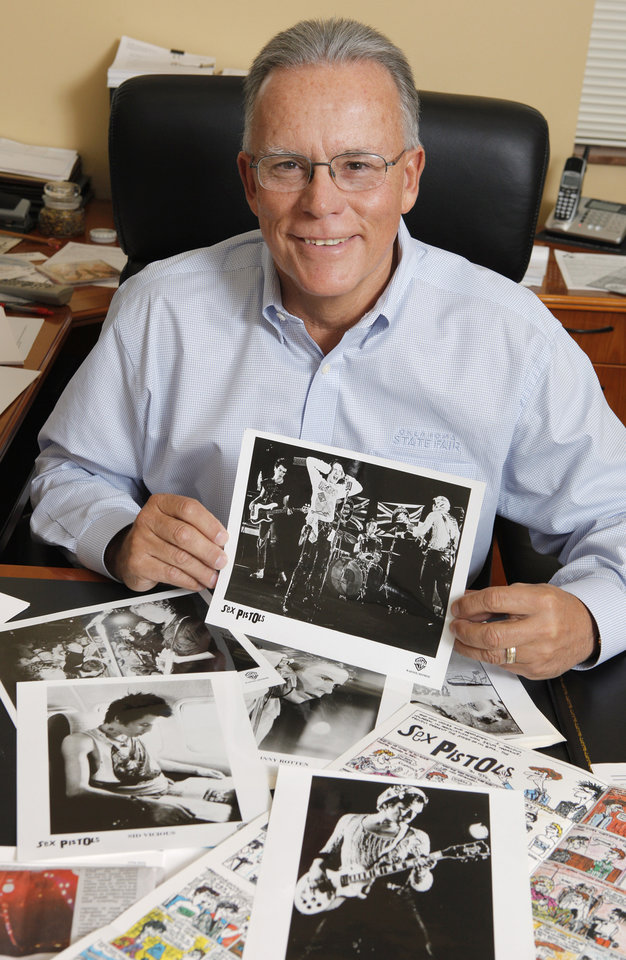 Scott Munz, vice president of marketing and public relations, in his office at Oklahoma State Fair, Inc. in Oklahoma City Wednesday, Feb. 22, 2012, with an original press kit from a 1977 Sex Pistols show. Photo by Paul B. Southerland, The Oklahoman