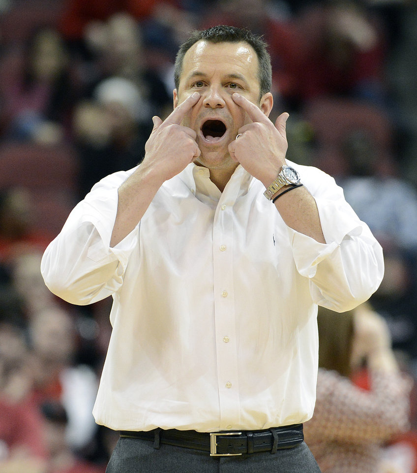Louisville head coach Jeff Walz questions a call during the second half of their second round game in the women's NCAA college basketball tournament in Louisville, Ky., Tuesday March 26, 2013. Louisville defeated Purdue 76-63. (AP Photo/Timothy D. Easley)
