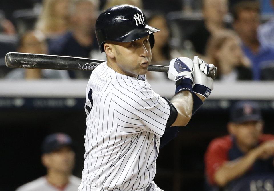 Photo - New York Yankees shortstop Derek Jeter (2) hits a third-inning, RBI single in a baseball game at Yankee Stadium in New York, Sunday, June 29, 2014. Ichiro Suzuki scored on the play. (AP Photo/Kathy Willens)
