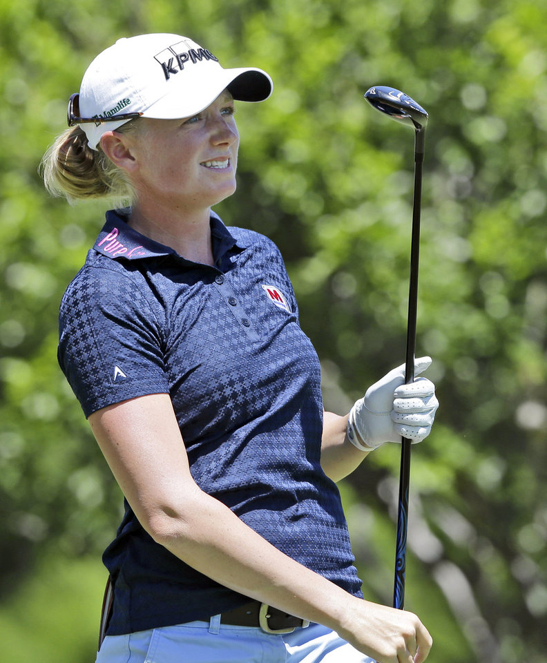 Photo - Stacy Lewis watches her tee shot on the second hole during the third round of the North Texas LPGA Shootout golf tournament at the Las Colinas Country Club in Irving, Texas, Saturday, May 3, 2014. (AP Photo/LM Otero)