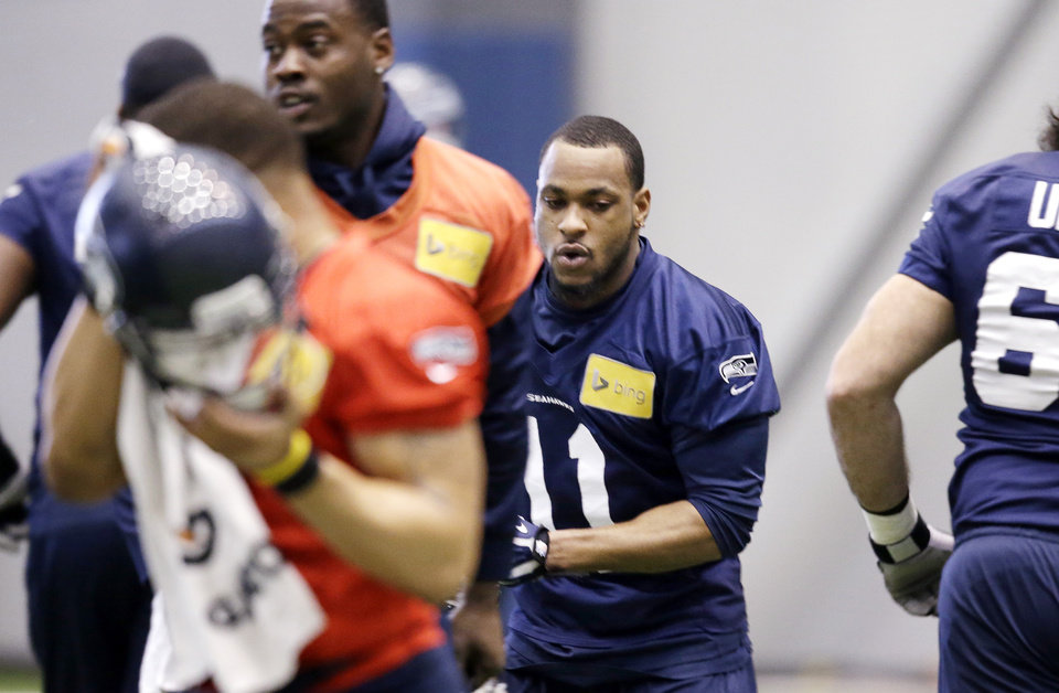 Photo - Seattle Seahawks' Percy Harvin (11) jogs into position for NFL football practice Tuesday, Jan. 7, 2014, in Kirkland, Wash. The Seahawks host the New Orleans Saints on Saturday in an NFC divisional playoff game. (AP Photo/Elaine Thompson)