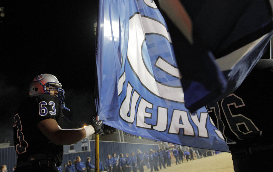 Photo - Guthrie's Zack Brown (63) holds a flag before a high school football game between Guthrie and East Central at The Rock in Guthrie, Friday, Nov. 18, 2011.  Photo by Garett Fisbeck, The Oklahoman