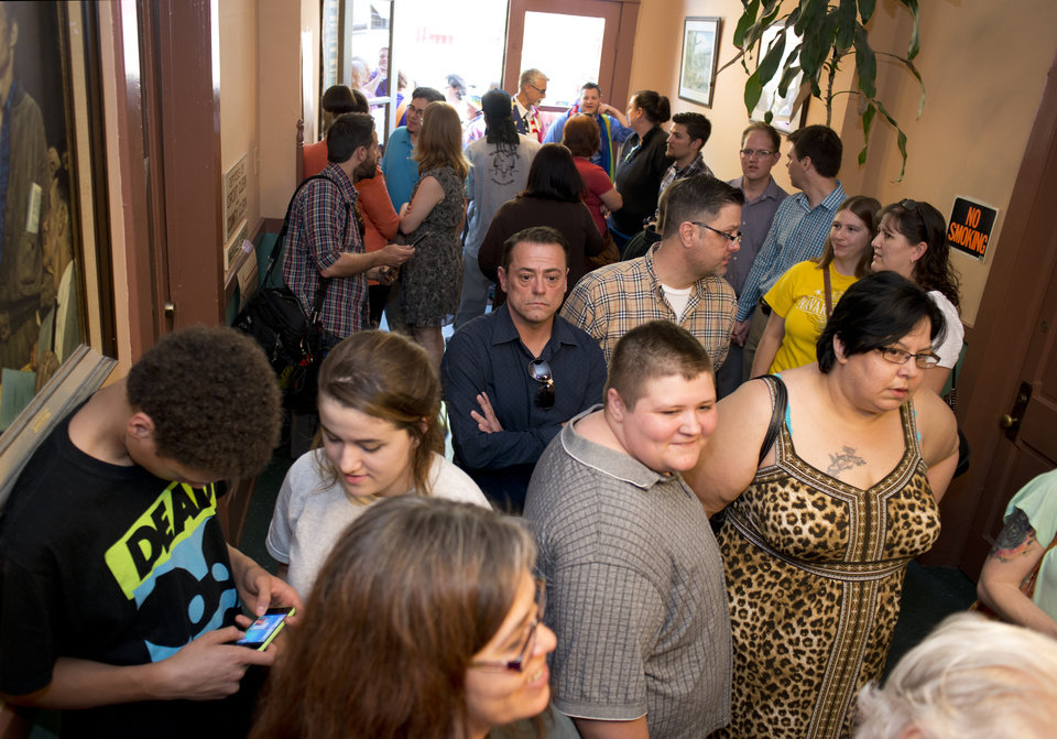Photo - A crowd gathers inside the Carroll County Courthouse to apply for a marriage license in Eureka Springs, Ark., Saturday, May 10, 2014. A judge overturned amendment 83 on Friday, which banned same-sex marriage in the state of Arkansas. (AP Photo/Sarah Bentham)