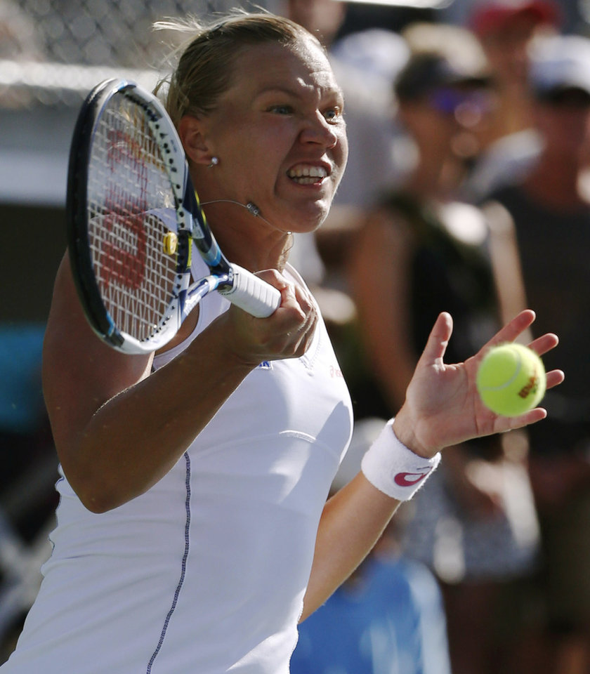 Photo - Kaia Kanepi, of Estonia, returns a shot against Samantha Stosur, of Australia, during the second round of the 2014 U.S. Open tennis tournament, Thursday, Aug. 28, 2014, in New York. (AP Photo/Kathy Willens)
