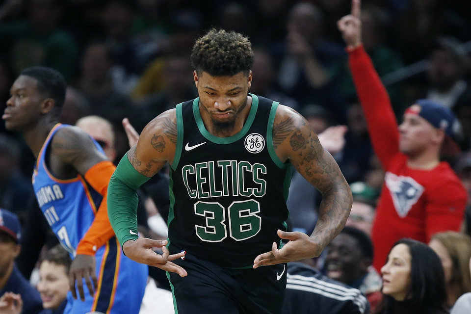 Photo - Boston Celtics' Marcus Smart (36) reacts after making a three-point basket during the second half of an NBA basketball game against the Oklahoma City Thunder in Boston, Sunday, Feb. 3, 2019. (AP Photo/Michael Dwyer)