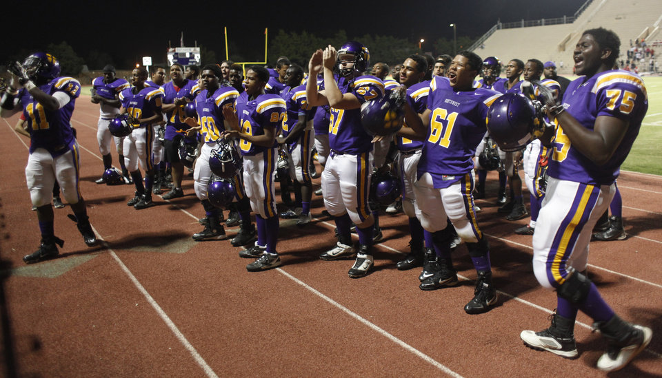 NWC players watch the band play the Alma Mater after the game at the Northwest Classen vs. Western Heights high school football game at Taft Stadium Thursday, September 20, 2012. Photo by Doug Hoke, The Oklahoman