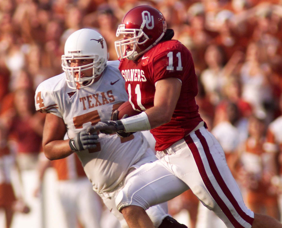 Linebacker Teddy Lehman returns an interception during Oklahoma's 35-24 win over Texas in 2002. PHOTO BY DOUG HOKE, THE OKLAHOMAN ARCHIVE