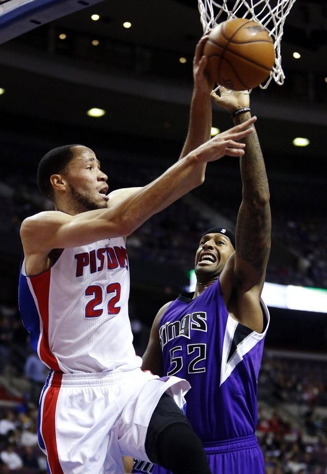 Detroit Pistons forward Tayshaun Prince (22) passes off against Sacramento Kings forward James Johnson (52) in the second half of an NBA basketball game, Tuesday, Jan. 1, 2013, in Auburn Hills, Mich. Prince scored 10 points in a 103-97 win. (AP Photo/Duane Burleson)
