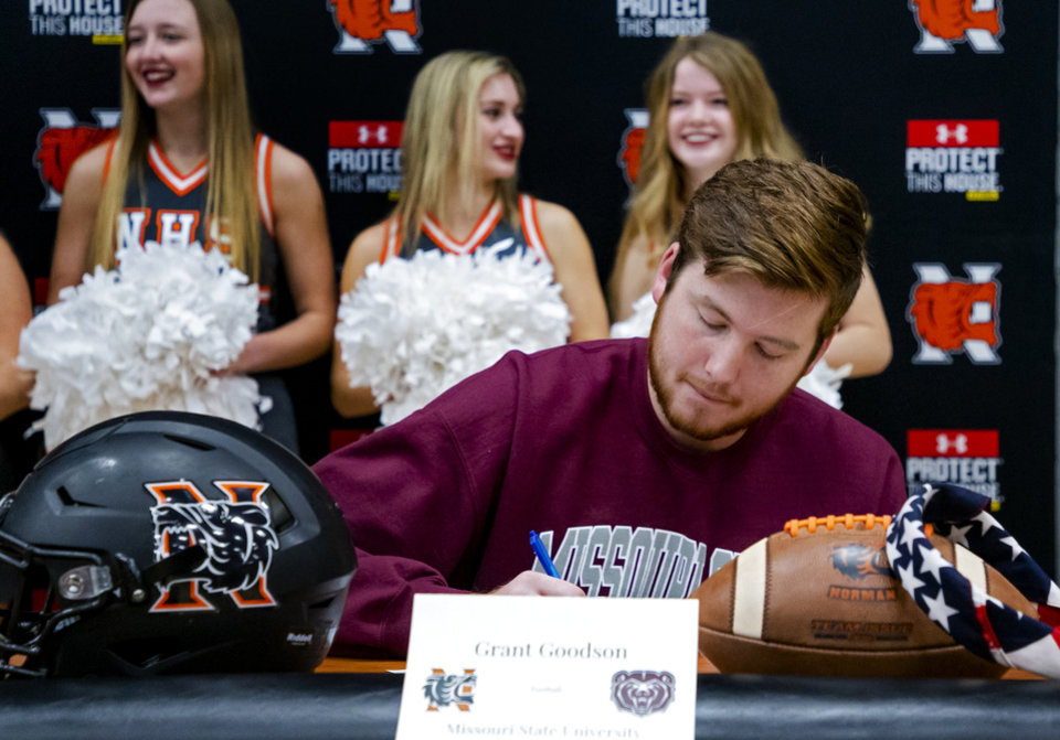 Photo - Missouri State University signee Grant Goodson celebrates signing his letter of intent during a national signing day ceremony for football at Norman High School in Norman Okla. on Wednesday, Dec. 18, 2019.   [Chris Landsberger/The Oklahoman]