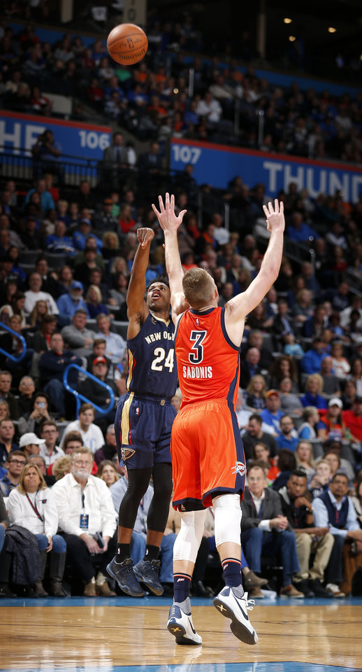 Photo - New Orleans' Buddy Hield (24) shoots over Oklahoma City's Domantas Sabonis (3) during the NBA game between the Oklahoma City Thunder and the New Orleans Pelicans at the Chesapeake Energy Arena,  Sunday, Dec. 4, 2016. Photo by Sarah Phipps, The Oklahoman
