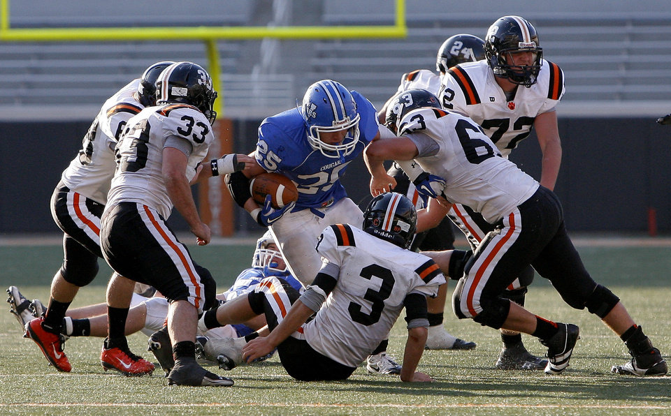 Photo - CLASS A HIGH SCHOOL FOOTBALL STATE CHAMPIONSHIP: Woodland's Tracey Wilson is stuffed by the Wayne defense during the Class A football championship football game between Woodland and Wayne at Boone Pickens Stadium in Stillwater, Okla., Saturday, Dec. 10, 2011. Photo by Sarah Phipps, The Oklahoman