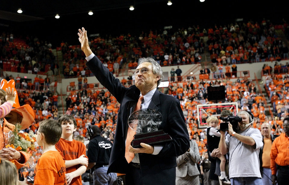 Photo - Stillwater, Okla. - January 15, 2005. Oklahoma State University Cowboys (OSU) vs. Iowa State University (ISU) men's college basketball in Gallagher-Iba Arena.     NAME, NAMING: Oklahoma State head coach Eddie Sutton waves to the crowd after the announcement that the basketball court will be named after him. The victory over Iowa State, 83-73, gave Sutton his 768th win, one more than his mentor, Henry Iba. By Nate Billings/The Oklahoman