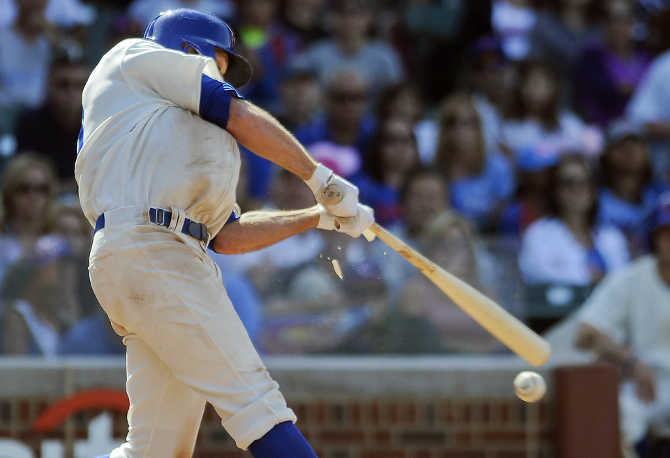 Photo - Chicago Cubs right fielder Nate Schierholtz breaks his bat during the ninth inning of a baseball game against the Pittsburgh Pirates, on Sunday, June 22, 2014, in Chicago. (AP Photo/Matt Marton)