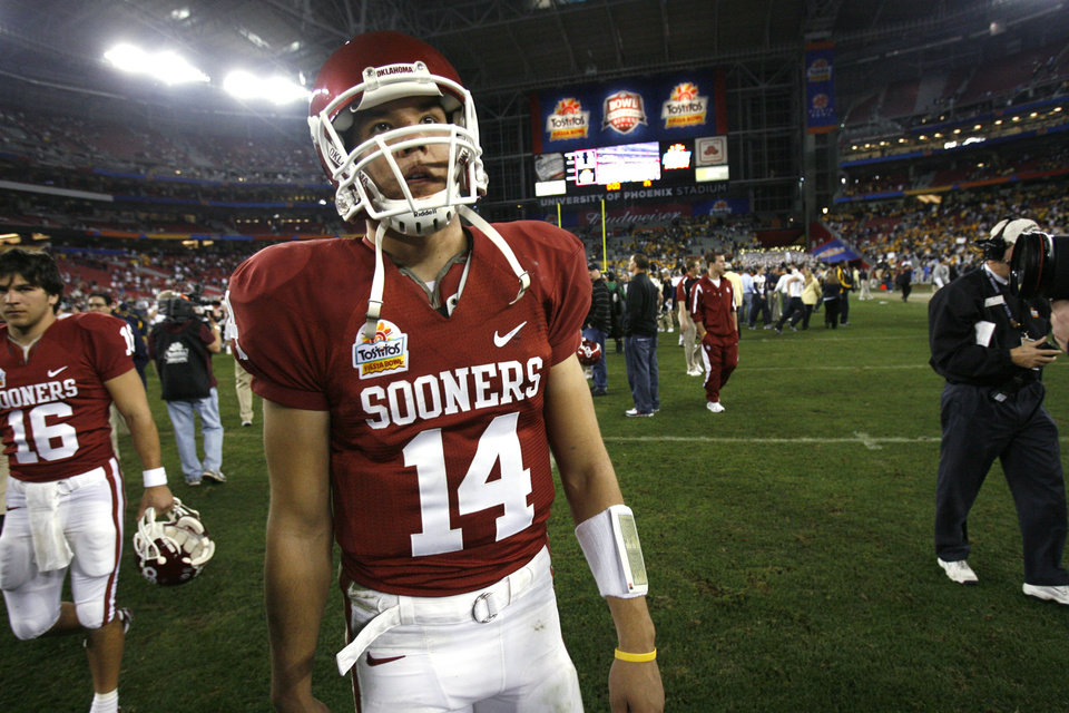 Photo - Quarterback Sam Bradford leaves the field at the end of the Fiesta Bowl college football game between the University of Oklahoma Sooners (OU) and the West Virginia University Mountaineers (WVU) at The University of Phoenix Stadium on Wednesday, Jan. 2, 2008, in Glendale, Ariz. 