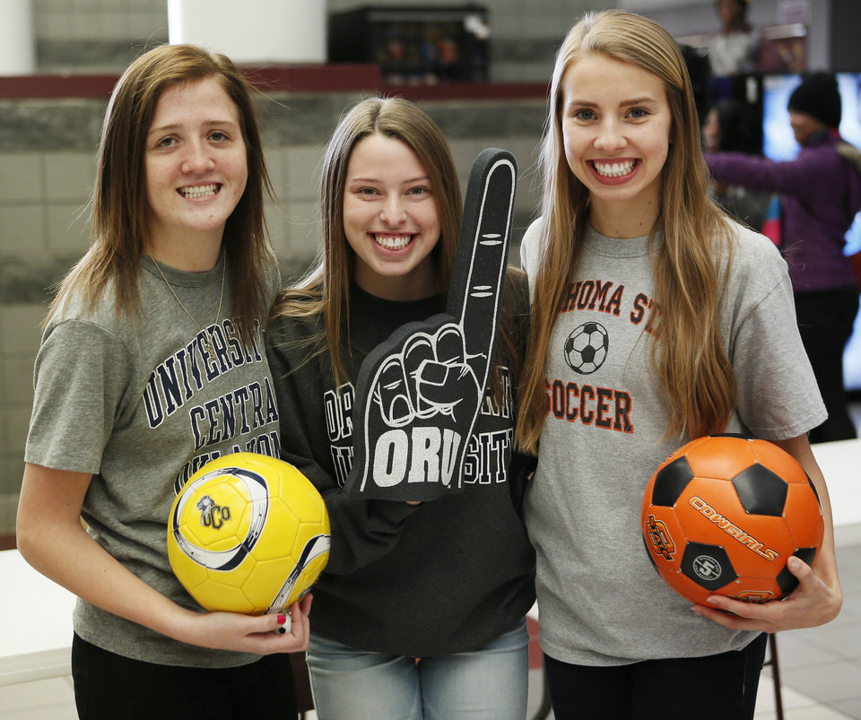 Photo - From left, soccer signees Reagan Ballard, UCO, Amanda Dial, ORU, and Lana Duke, OSU, pose for a photo during signing day for student athletes at Edmond Memorial High School in Edmond, Okla., Wednesday, Feb. 5, 2014. Photo by Nate Billings, The Oklahoman