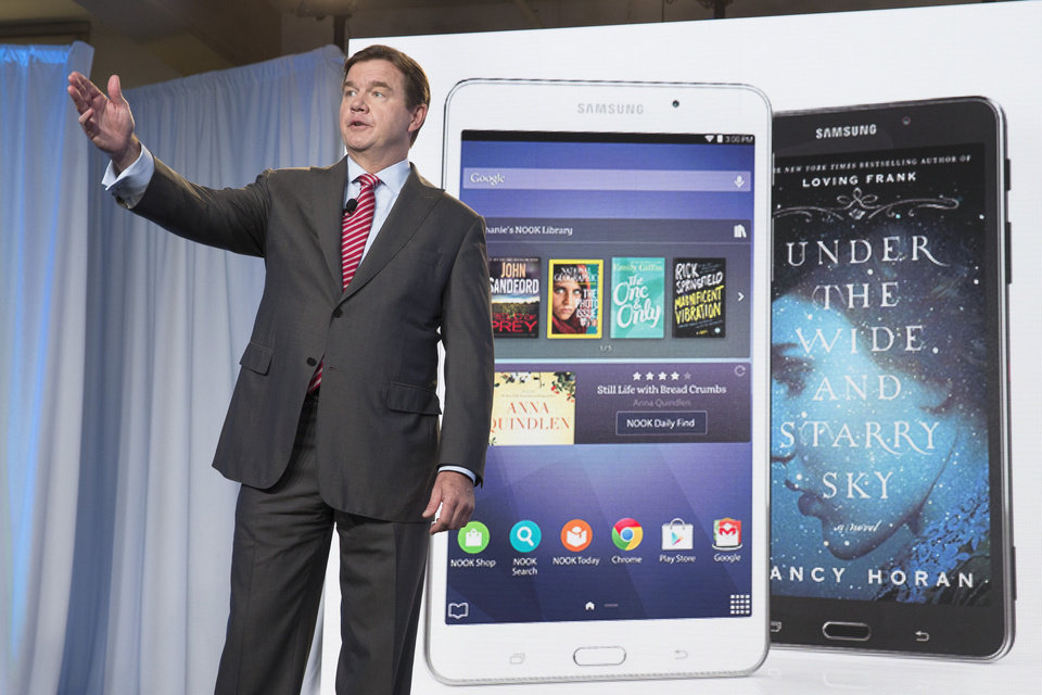 Photo - Mike Huseby, CEO of Barnes & Noble, speaks during the unveiling of the Samsung Galaxy Tab 4 Nook, a co-branded tablet that will replace B&N's Nook, Wednesday, Aug. 20, 2014, in New York. The 7-inch tablet will sell for $179 after a $20 instant rebate, the same entry price of the non-branded Samsung Galaxy Tab 4. (AP Photo/John Minchillo)
