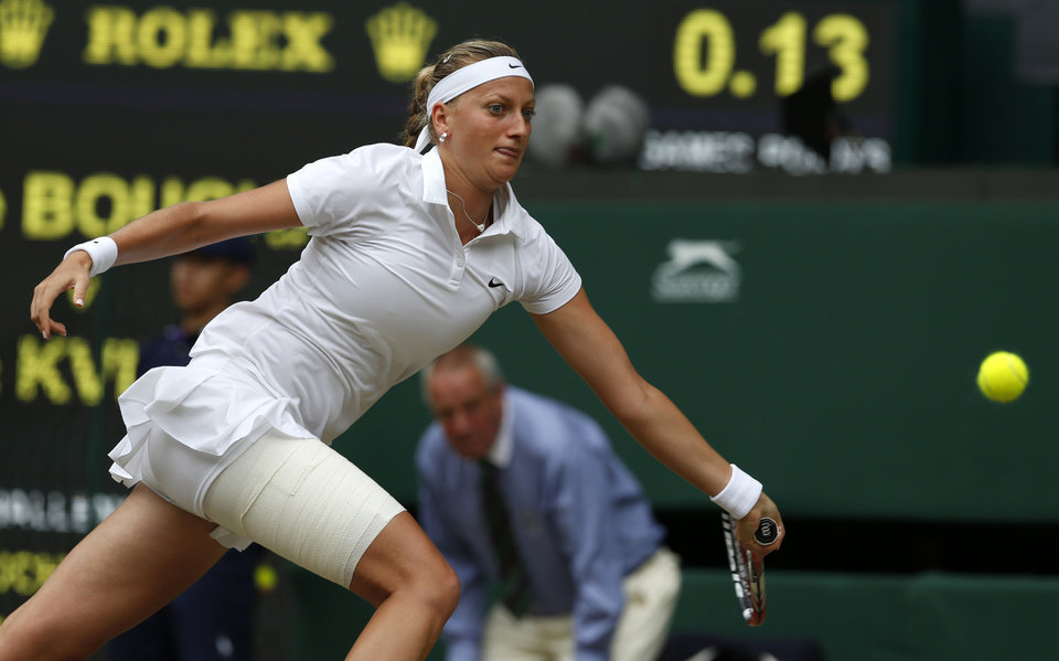 Photo - Petra Kvitova of the Czech Republic plays a return to Eugenie Bouchard of Canada during the women's singles final at the All England Lawn Tennis Championships in Wimbledon, London, Saturday July 5, 2014. (AP Photo/Sang Tan)