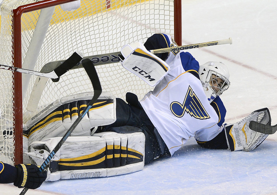 Photo - St. Louis Blues goalie Ryan Miller (39) fails to stop a goal by Nashville Predators forward Eric Nystrom in the second period of an NHL hockey game on Saturday, March 15, 2014, in Nashville, Tenn. (AP Photo/Mark Zaleski)