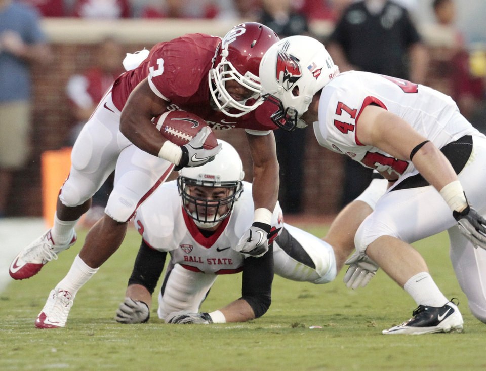 Oklahoma Sooners\' Brennan Clay (3) hits the helmet of Ball State Cardinals\' Tony Martin (47) and is injured during the first half of the college football game between the University of Oklahoma Sooners (OU) and the Ball State Cardinals at Gaylord Family-Oklahoma Memorial Stadium on Saturday, Oct. 1, 2011, in Norman, Okla. Photo by Steve Sisney, The Oklahoman