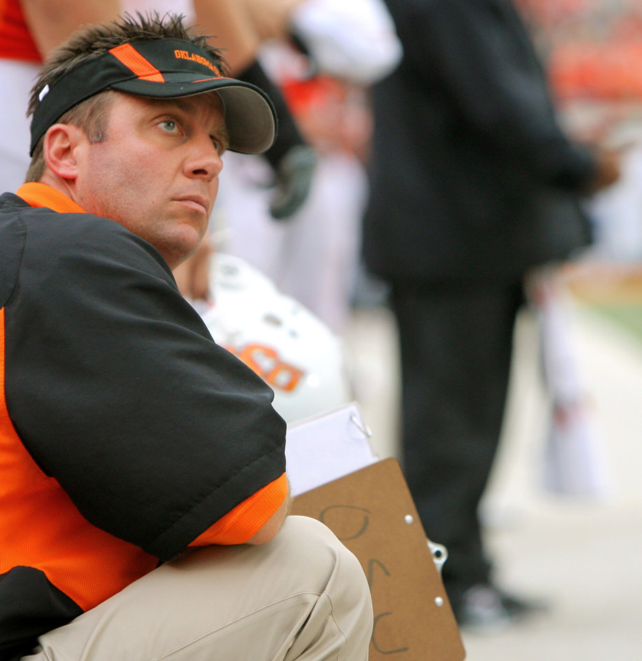 Photo - OSU head coach Mike Gundy looks up at the scoreboard in the fourth quarter at the Oklahoma State University (OSU) football game against Missouri State University (MSU) Saturday Sept. 13, 2008 at Boone Pickens Stadium in Stillwater, Okla. BY MATT STRASEN, THE OKLAHOMAN.