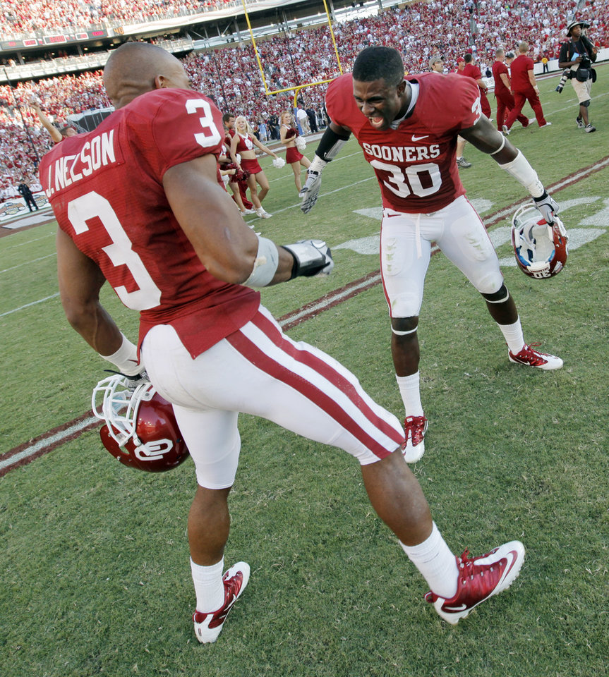 Photo - OU's Jonathan Nelson (3) and Javon Harris (30) celebrate after the Red River Rivalry college football game between the University of Oklahoma Sooners (OU) and the University of Texas Longhorns (UT) at the Cotton Bowl on Saturday, Oct. 2, 2010, in Dallas, Texas. OU won, 28-20. Photo by Nate Billings, The Oklahoman