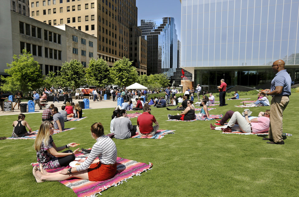 Photo -  Downtown Oklahoma City Partnership treated downtown workers to free pizza, snow cones and live music at its annual Employee Appreciation Day in June. Hundreds of workers relaxed in Kerr Park and took part in this event, billed by the host as a fun and laid-back lunchtime party. [Photo by Jim Beckel, The Oklahoman Archives]