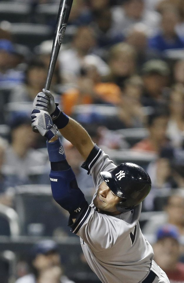 Photo - New York Yankees' Derek Jeter swerves to avoid an inside pitch from New York Mets relief pitcher Jeurys Familia in the eighth inning of a baseball game in New York, Thursday, May 15, 2014. (AP Photo/Kathy Willens)