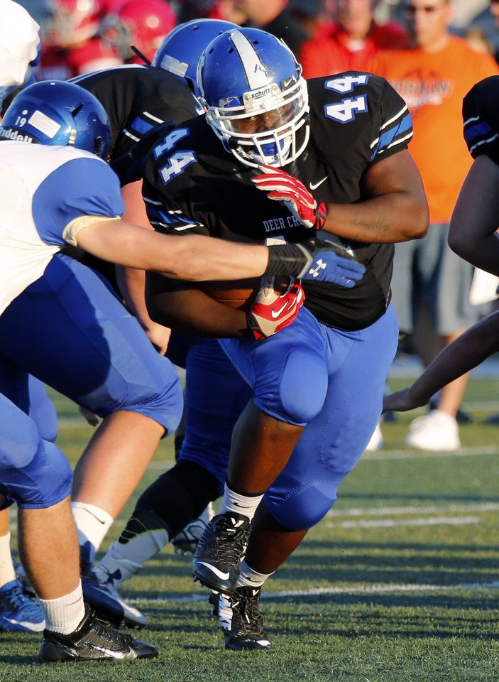 Photo - Deer Creek's Juan Hill carries in the Top of the World scrimmage at Harve Collins Field in Norman, Okla., on Friday, Aug. 29, 2014. Photo by Steve Sisney, The Oklahoman
