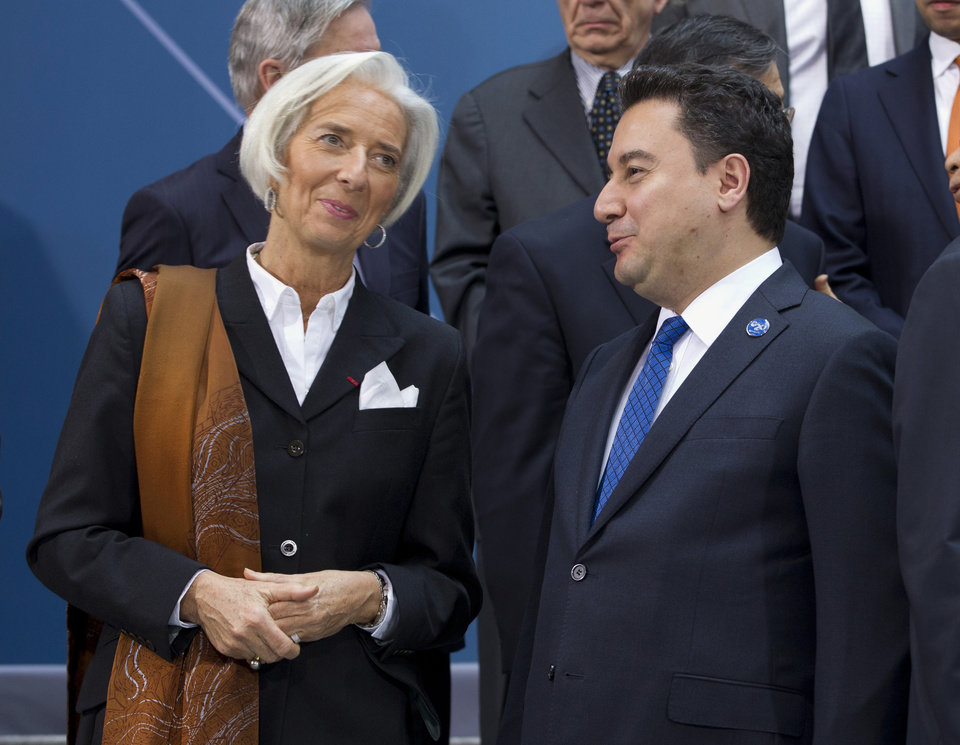 Photo - International Monetary Fund (IMF) Managing Director Christine Lagarde speaks with Turkish Deputy Prime Minister Ali Babacan, during the G-20 finance ministers and central bank governors group photo on the sidelines of their meeting at World Bank Group-International Monetary Fund Spring Meetings in Washington, Friday, April 11, 2014. ( AP Photo/Jose Luis Magana)