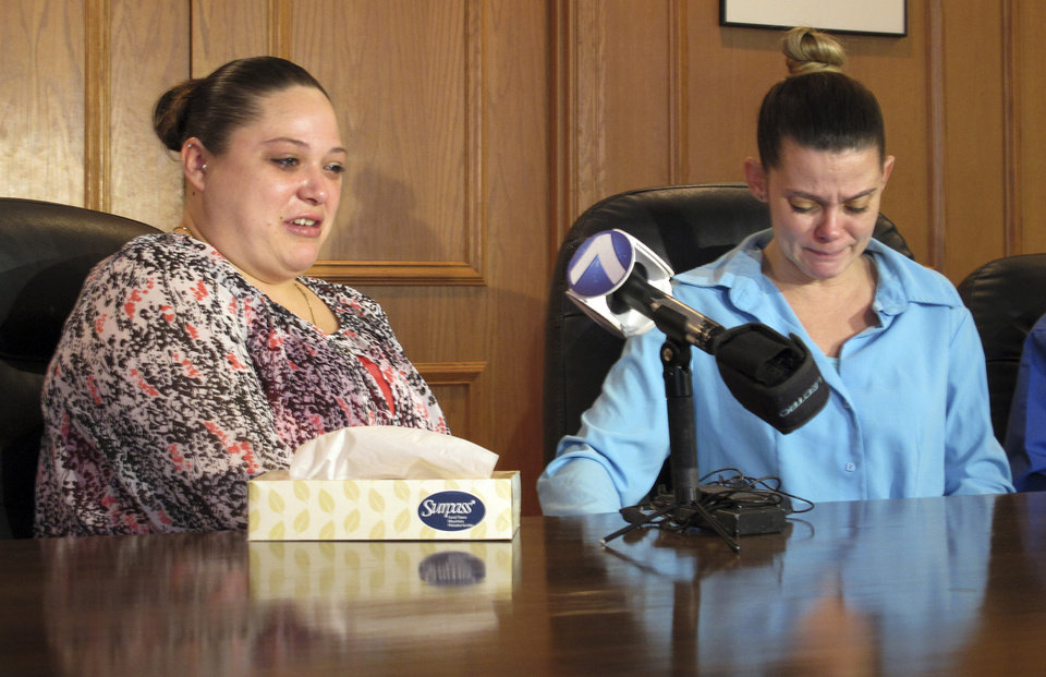 "Photo - Amber McGuire, left, recounts the execution of her father, Dennis McGuire, as her sister-in-law Missie McGuire cries at a news conference Friday, Jan. 17, 2014, in Dayton, Ohio, where they announced a planned lawsuit against the state over the unusually slow execution. McGuire's lawyers had attempted last week to block his execution, arguing that the untried method could lead to a medical phenomenon known as ""air hunger"" and could cause him to suffer"